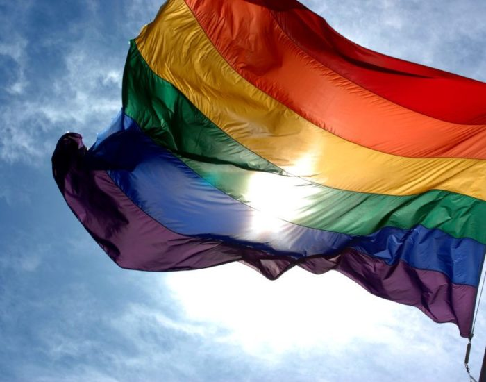 Rainbow_flag_and_blue_skies-1024x681